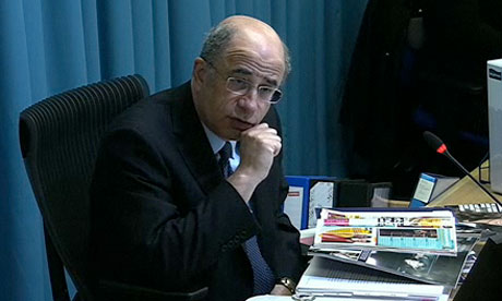 Lord Justice Leveson witha copy of Heat magazine