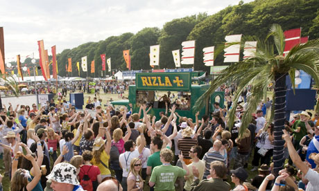 Festival goers enjoy the sounds of the Rizla Invisible Players van