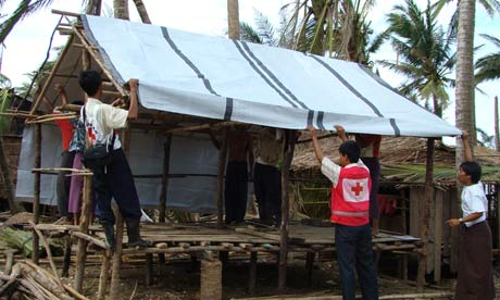 Aid workers from the Red Cross. Photograph: Htien Win / International Federation of Red Cross and Red Crescent Societies