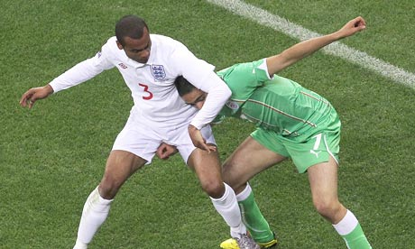 Ashley Cole, left, battles for possession with Algeria's Ryad Boudebouz