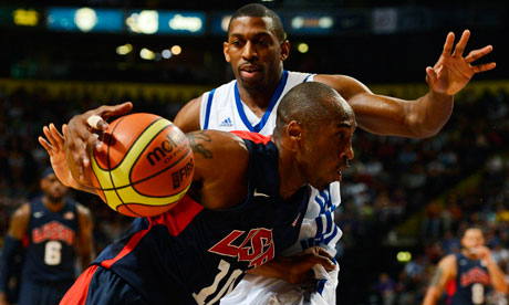 Mike Lenzly of Team GB challenges Kobe Bryant of Team USA