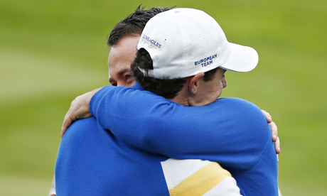 Graeme McDowell, right, celebrates with Rory McIlroy after winning his Ryder Cup match for Europe.