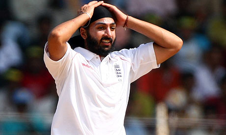 Monty Panesar of England reacts as one of his deliveries is hit to boundary against India