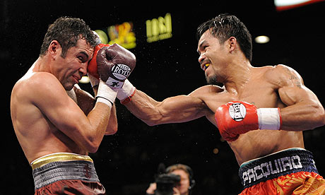 http://static.guim.co.uk/sys-images/Sport/Pix/pictures/2008/12/7/1228638263292/Manny-Pacquiao-and-Oscar--001.jpg