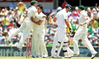 Mitchell Johnson is congratulated by Australia team-mates after dismissing England's Kevin Pietersen