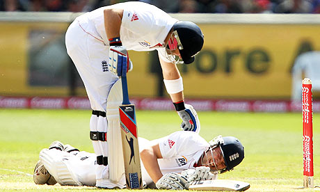 Matt Prior stands over an injured Jonathan Trott