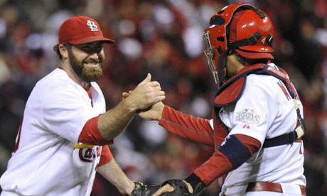 St. Louis Cardinals relief pitcher Jason Motte and catcher Yadier Molina