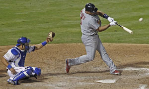St. Louis Cardinals' Albert Pujols hits a home run v Texas Rangers
