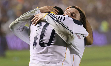 Landon Donovan and David Beckham of LA Galaxy celebrate winning MLS Cup