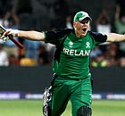 Kevin O'Brien celebrates scoring 100 against England