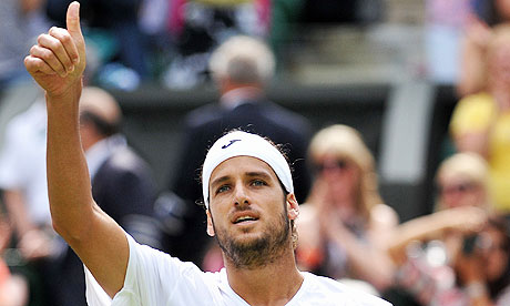 Feliciano Lopez celebrates after beating Andy Roddick