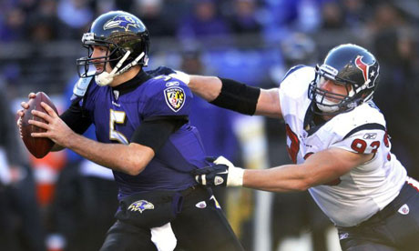 Baltimore Ravens QB Joe Flacco is tackled by Houston Texans' Tim Bulman