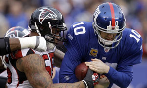 New York Giants' Eli Manning is sacked by Atlanta Falcons