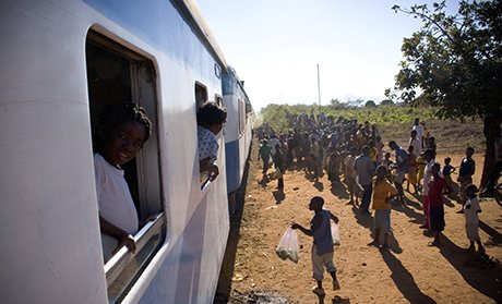 Vendors greet the train in Mozambique.