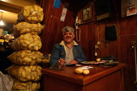 Potato salesmam at La Central de Abasto, Mexico City.
