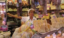 A vendor at San Remo's farmer's market in Liguria, Italy