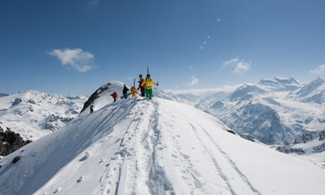 Riders hike up to the start line in Verbier