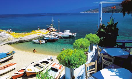 Restaurant, bay and fishing boats, Ikaria, Greece