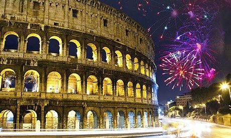 Celebratory fireworks over Colosseum, Rome, Italy
