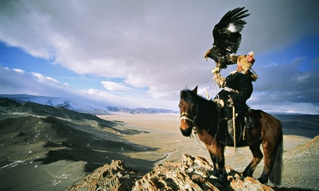A Kazakh man and his trained golden eagle.