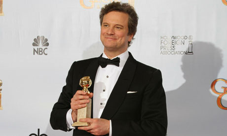 Actor Colin Firth poses with his award f