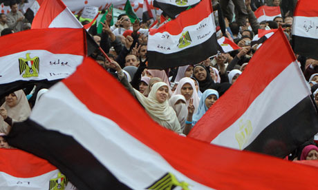 Egyptian women wave flags during a rally in Cairo's Tahrir square