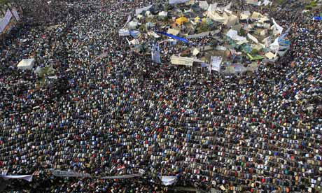 Demonstrators perform Friday prayers at Tahrir square in Cairo