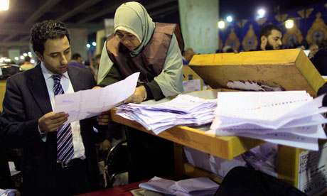 Electoral workers count ballots during parliamentary elections in Cairo, Egypt