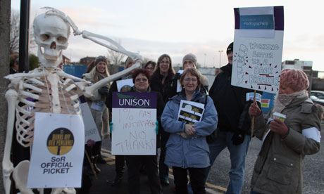 Radiographers from the Royal Liverpool Hospital stand on a picket line