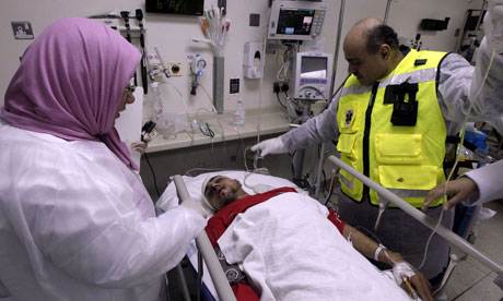 A wounded Bahraini demonstrator is treated in Manama