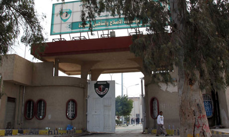 The open gates of  Al-Jadid prison in Tripoli after guards deserted the jail