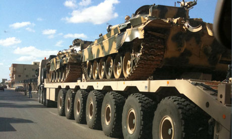 Libyan tanks on trailers near Tripoli