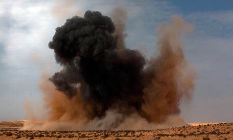 A bomb is dropped by the Libyan airforce on the outskirts of Brega