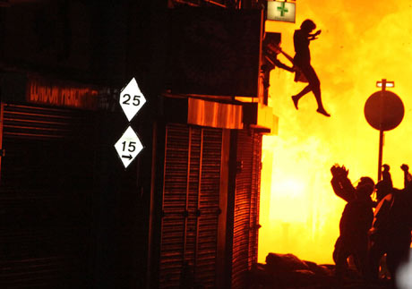 A woman leaps from a burning building in Surrey Street, Croydon
